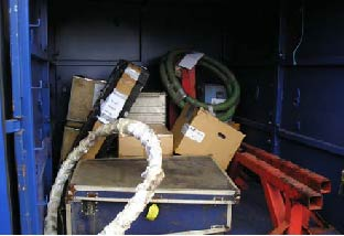 The contents of a freight container are left unsecured. Some are labelled as fragile