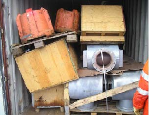 Orange clump weights (500kg) unsecured and stored on top of lighter materials